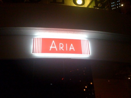 ARIA Brisbane's sign shines from its location on Eagle Street Pier