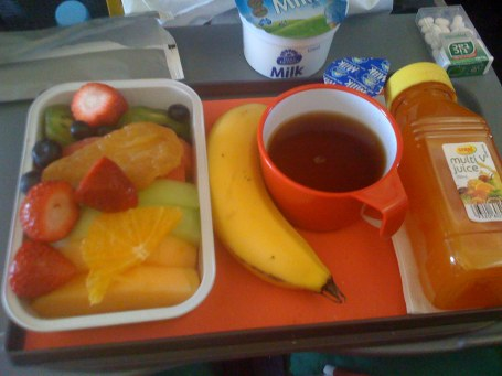 The Qantas Brisbane -> Sydney breakfast fruit platter, with banana, juice and tea