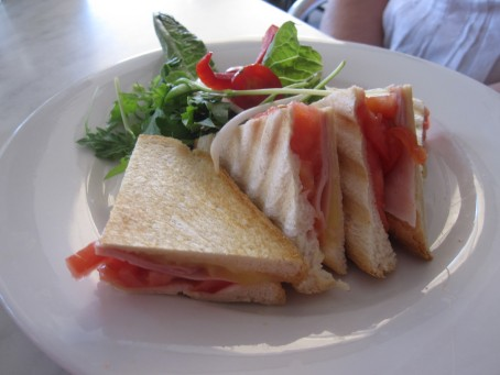 Sandwich: shaved leg ham off bone w/ jarlsberg cheese, fresh tomato & tomato relish