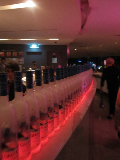 Long line of Grey Goose vodka along the bar