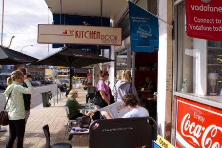Sunny outdoor tables on Lawrence St at The Kitchen Door, Freshwater