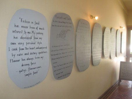 Plaques along the wall in Maggie's Farm Shop